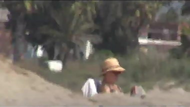 Flashing cock to  granny in the  beach