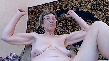 old granny with floppy tits flexes on cam