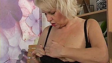 Naughty granny in black feels very horny today