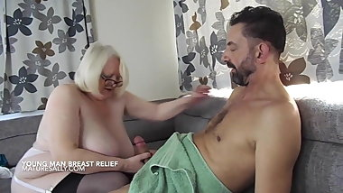 Sally gives a younger guy breast relief
