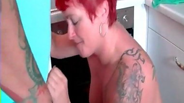 Pierced and tattooed granny sucking cock