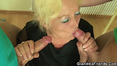 Blonde granny teacher takes double penetration