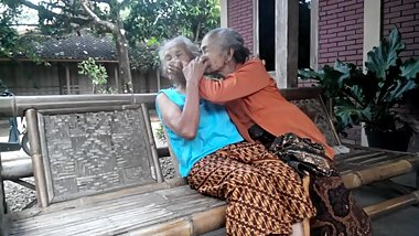 2 very old grannies kissing