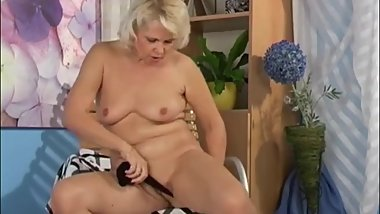 Horny granny in stockings having solo fun with favored toy