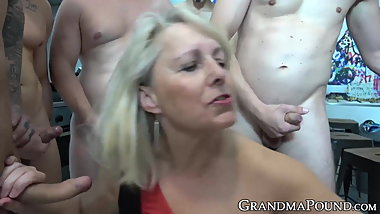 Pretty granny gang banged by many hung males